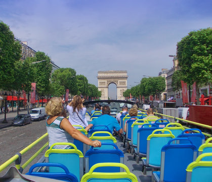 tourist bus in Paris France. Champs Elysees boulevard in summer