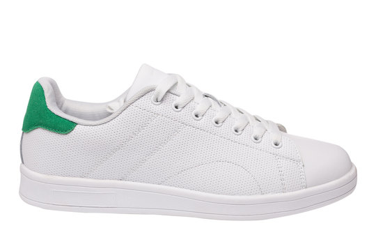 white leather sneakers, green insert, sports shoes on a white background