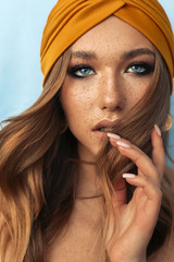 Obraz portrait of beautiful young woman with brown hair and freckles face - fototapety do salonu