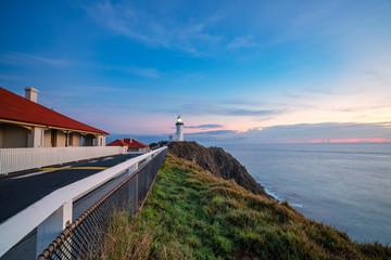 Byron Bay lighthouse at sunrise with vibrant sky
