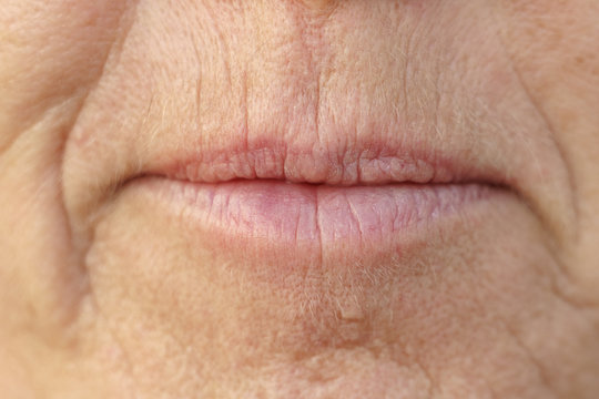 Extreme Closeup on the mouth of a middle-aged woman