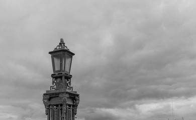 Lamppost against a cloudy sky
