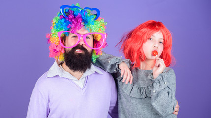 How crazy is your father. Man bearded father and girl wear colorful wig while eat lollipop candy. Thing loving father do for children. Tribute to fun dad. Easy simple ways be fun playful parent