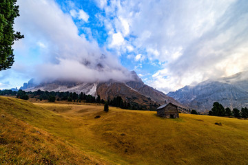 Fototapete - Wooden rural farmer's shed (hut) in Seiser Alm meadow in the Dolomites, North Italy, Sudtirol (Trentino / Alto Adige). Scenic autumn view of a big valley in the Alps Mountains.