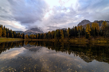 Fototapete - Autumn landscape of Antorno lake with famous Dolomites mountain peak of Tre Cime di Lavaredo in background in Dolomites, Italy. Beautiful nature scenery and scenic travel destination in Fall time.