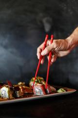 hand picking sushi