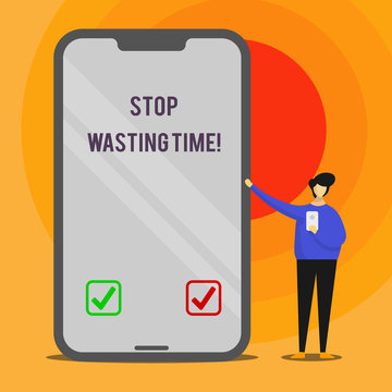 Word writing text Stop Wasting Time. Business photo showcasing advising demonstrating or group start planning and use it wisely Man Presenting Huge Blank Screen Smartphone while Holding Another Mobile