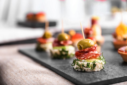 Tasty canapes on slate plate