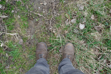 View of dirty shoes on grass