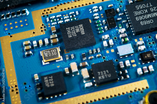 Macro shot of Circuit board with resistors microchips and
