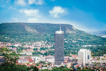 Panoramic view of hills, old town and tower. Jena, Germany