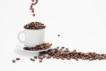 Foto op Canvas koffiebar White Coffee Cup With Fresh Coffee Beans Falling into the Cup on a White Background Concept with Copy Space