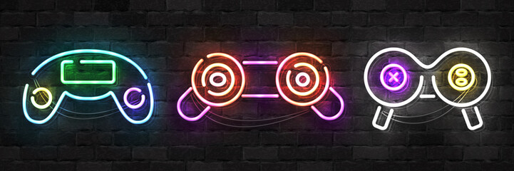 Vector set of realistic isolated neon sign of Game Controller logo for template decoration and mockup covering on the wall background. Concept of gaming.