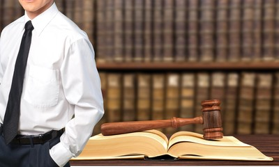 Successful lawyer with book and  judge gavel   ,Law concept