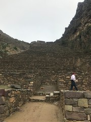 Man Walking at Ollantaytambo, Inca Ruin in Peru