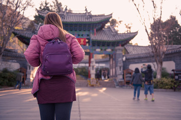 Backpack woman traveling in China.