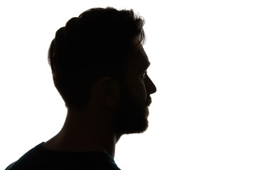 Silhouette of pensive man looking away isolated on white
