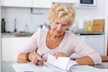 Woman filling up documents