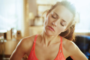 tired healthy woman at modern home stretching neck