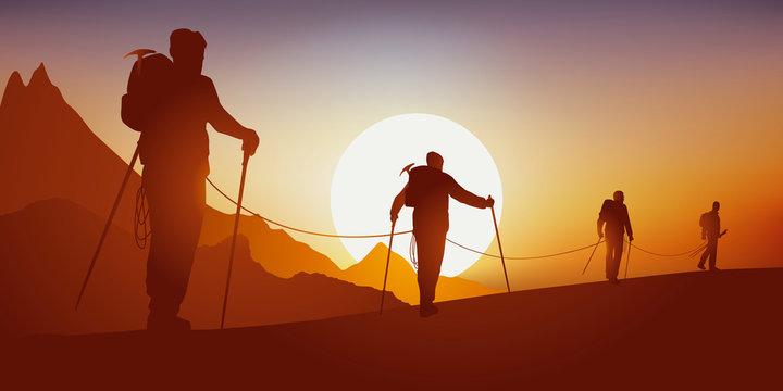 Concept de la solidarité, avec des alpinistes qui partent en expédition en marchant encordés sur la crête d'une montagne, avant d'escalader un sommet