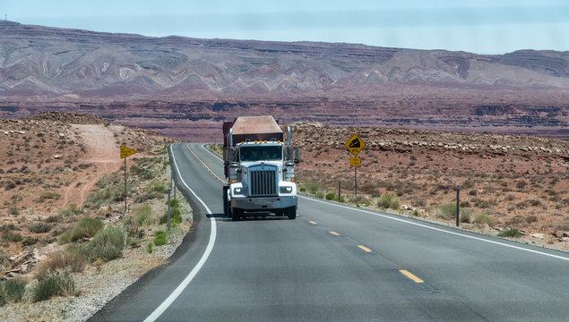 Big truck speeding up along Arizona road, united States