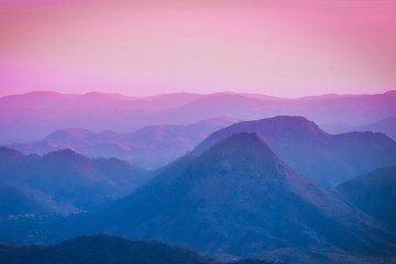 Beautiful blue pink sunset sky at the mountains landscape. Mountain Background. Fototapete