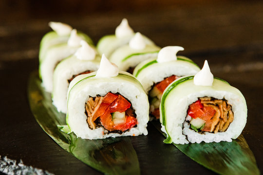 rolls with fresh fish, vegetables and cream cheese