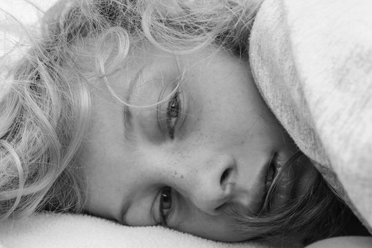 Black and white portrait of a lethargic girl waking up