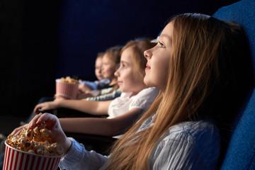 Children watching movie in cinema theatre.