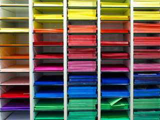 Shelf with many professional colorful sheets of paper for artists.