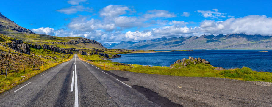 Ring road 1 in Eastern Iceland with the panoramic view at Stodvar Fjord at right.