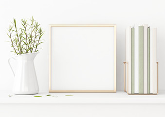 Square poster mockup with golden metal frame standing on table and decorated with jug, green plants and pile of books on empty white wall background. 3D rendering, illustration.