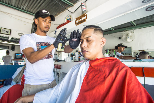 young latinos in traditional barbershop