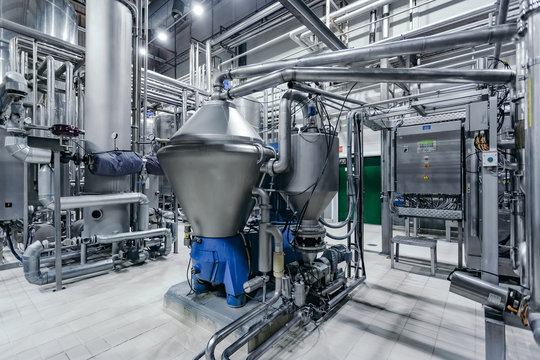 Modern brewery production line. Beer filtration equipment and pump machinery