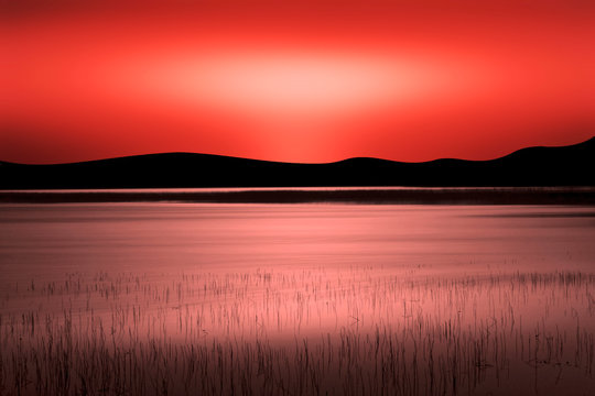 Red sunset over the lake
