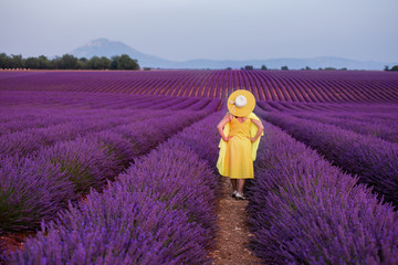 asian woman in yellow dress and hat at lavender field