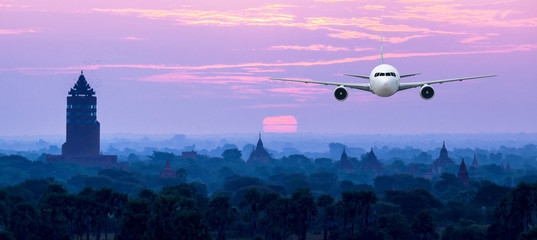 Front of real plane aircraft, on Pagoda Sunset in Bagan,Myanmar background