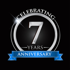 Celebrating 7 years anniversary logo. with silver ring and blue ribbon.