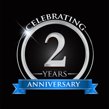 Celebrating 2 years anniversary logo. with silver ring and blue ribbon.
