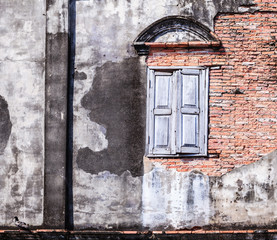 Vintage retro old aged window and brown color textured clay brick block wall. Architectural...