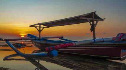jukung boat bali sunset