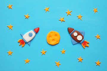 Two kid (child) rocket in space, adventure and science. Stars, and moon. Plasticine art, cartoon.