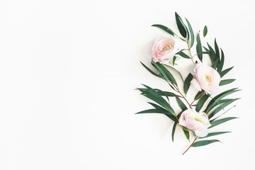 Foto auf Leinwand Blumen Flowers composition. Pink flowers and eucalyptus leaves on white background. Flat lay, top view, copy space