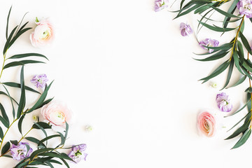 Wall Murals Floral Flowers composition. Purple flowers and eucalyptus leaves on white background. Flat lay, top view, copy space