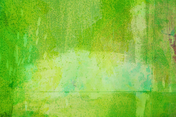 The abstract bright green surface has a brush painted on the background for graphic design.