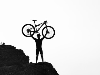 Clyclist at the top of the mountain