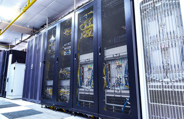 inside of the equipment for mobile communication in modern data center of mobile operators. Cabinets with the server equipment