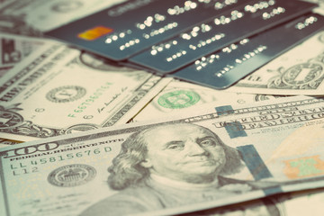 US Dollar banknotes money and Pile of credit cards using as consumer payment, debt or financial management