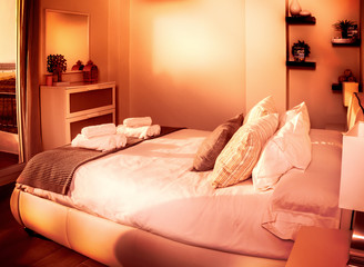 bedroom of a holiday apartment during sunset or sunrise