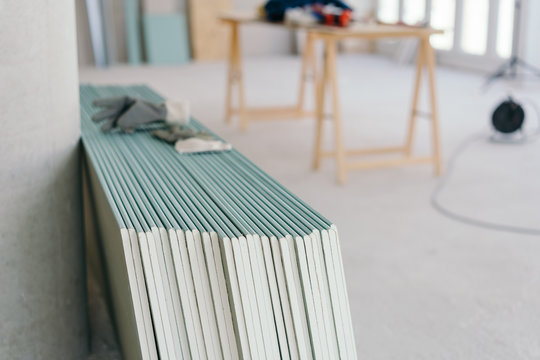 White chip board stacked inside a new build house